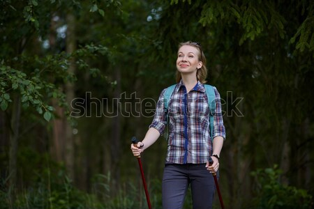 young woman with nordic walk pols Stock photo © svetography