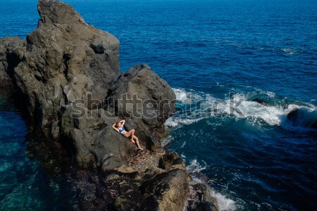 beautiful girl resting in natural ocean swimming pool Stock photo © svetography
