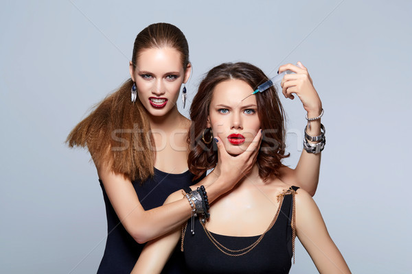glam girls getting beauty injection Stock photo © svetography