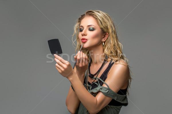 beautiful girl applying makeup Stock photo © svetography