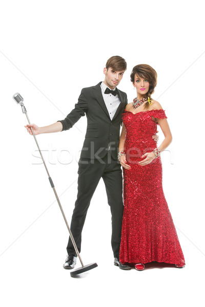 Woman and man performing song in retro microphone Stock photo © svetography