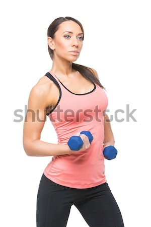 Sporty woman with dumbbells Stock photo © svetography