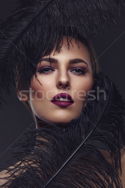 Beautiful girl with black feathers Stock photo © svetography