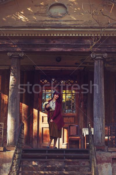 девушки Постоянный старом доме балкона красивой Сток-фото © svetography