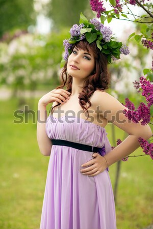 Girl with lilac Stock photo © svetography