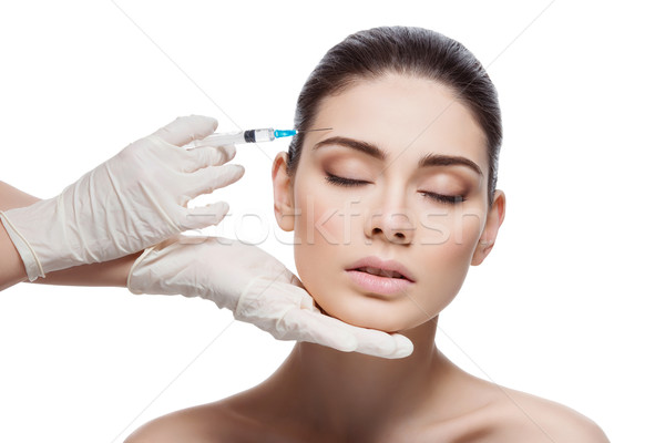 Woman gets collagen injection Stock photo © svetography
