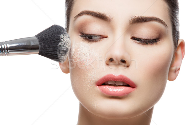 Beautiful girl applying loose powder with brush Stock photo © svetography