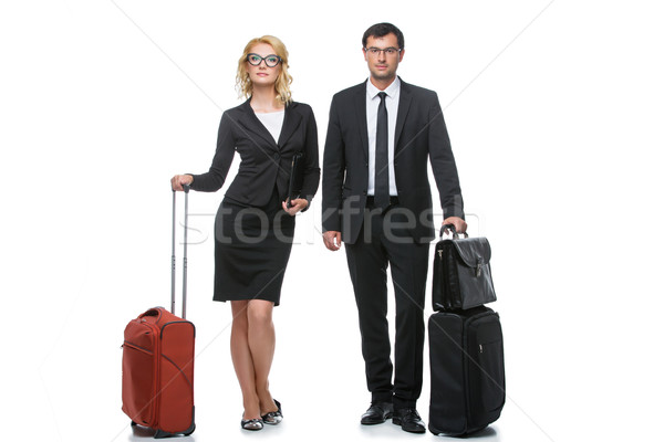 Businessman and business woman with travel cases Stock photo © svetography