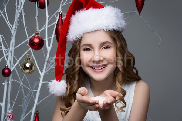 Beautiful girl in christmas cap Stock photo © svetography