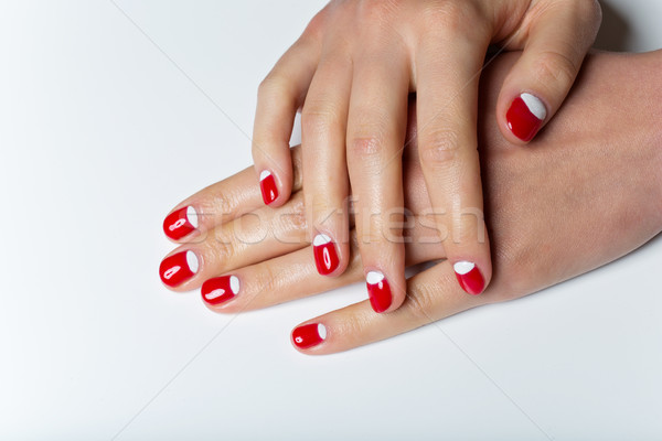 Female hands with red and white nails Stock photo © svetography