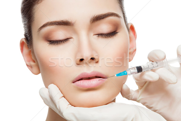 Girl gets injection Stock photo © svetography