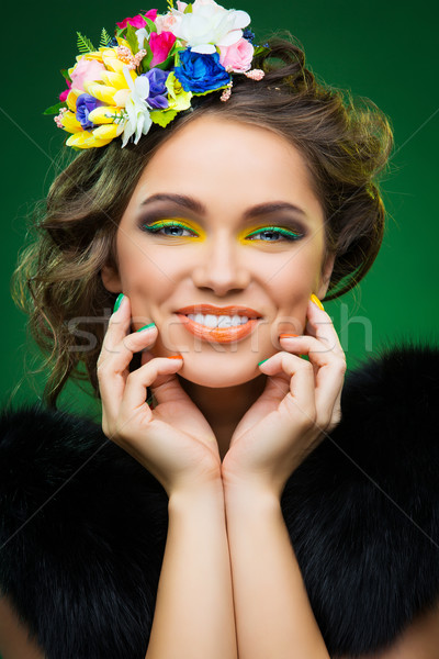 Stock photo: Beautiful young woman with flowers on head