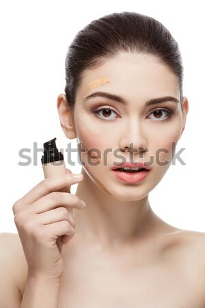 Girl with foundation cream on face Stock photo © svetography