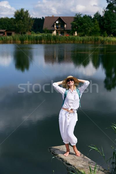 Young woman resting near lake Stock photo © svetography