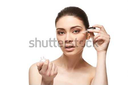 girl applying eye serum isolated on white Stock photo © svetography