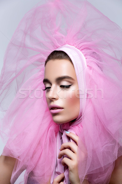 Beautiful girl in fluffy pink headwear Stock photo © svetography