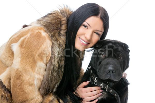 Girl with black shar pei dog Stock photo © svetography