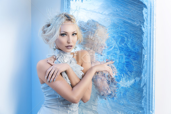 Snow queen near frozen mirror Stock photo © svetography