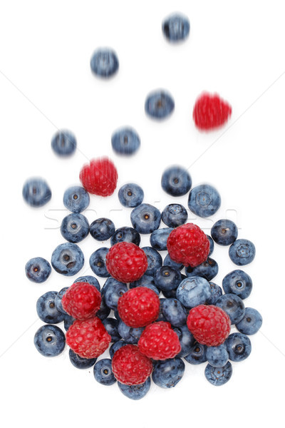 falling blueberry and raspberry berries isolated on white background Stock photo © svetography