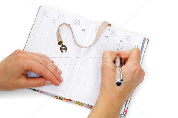 Notebook opened with female hands writing Stock photo © svetography