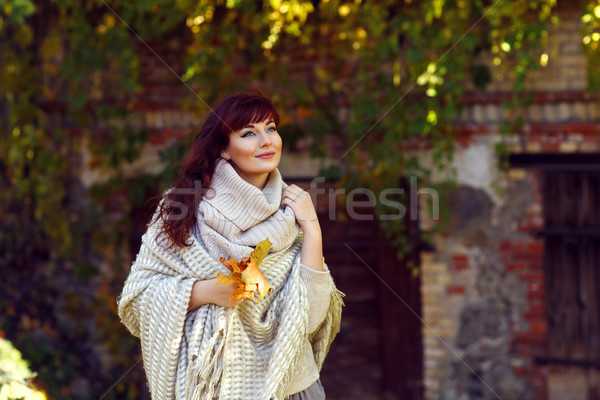 Beautiful girl outdoors with autumn leaves Stock photo © svetography