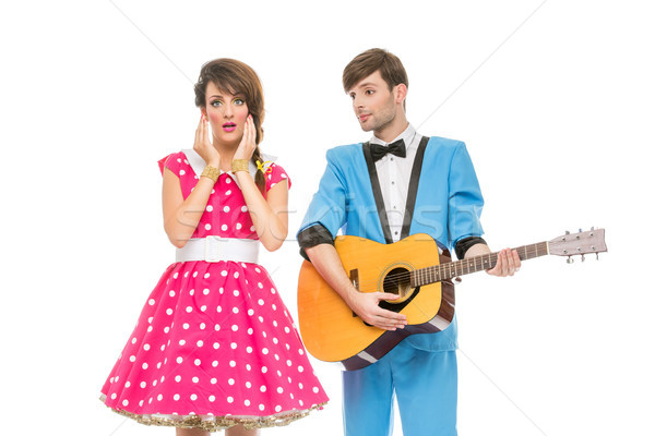 Stock photo: doll looking boy and girl with guitar