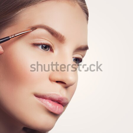 Woman correcting eyebrows form Stock photo © svetography
