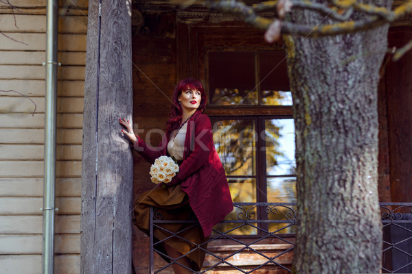 Lány ül régi ház erkély gyönyörű fiatal nő Stock fotó © svetography