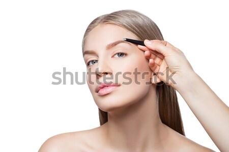 Woman correcting eyebrows form Stock photo © svetography