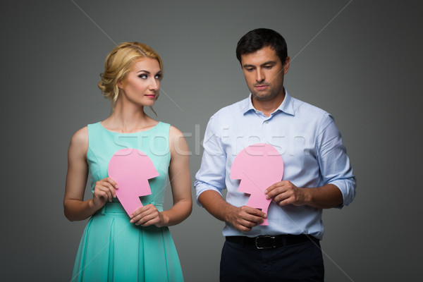 Beautiful couple holding pink broken heart Stock photo © svetography