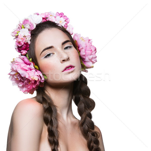 Stock photo: Beautiful girl with floral headphones
