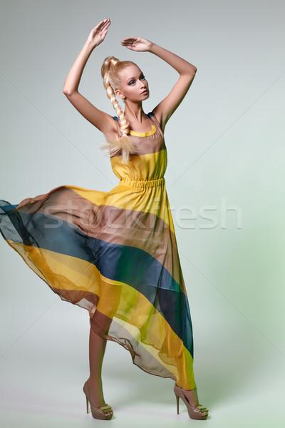 Hermosa niña vestido posando como muneca hermosa Foto stock © svetography
