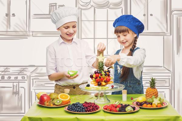 Children making fruit snacks Stock photo © svetography