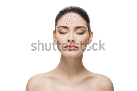 Girl with cream sun shape drawing on chest Stock photo © svetography