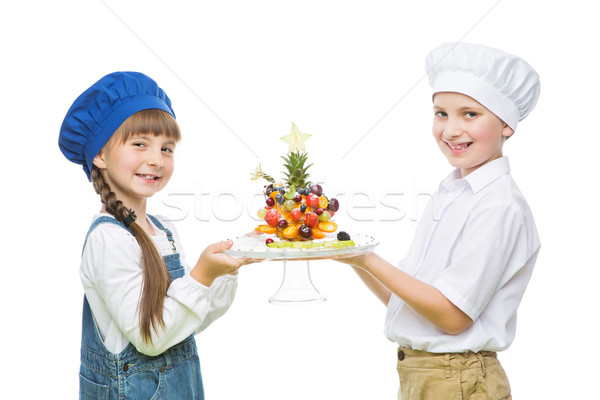 Gyerekek tart fa forma gyümölcs falatozó Stock fotó © svetography