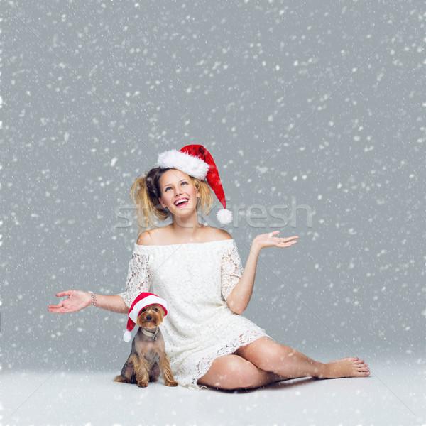 Beautiful girl with yorkie dog in santa cap Stock photo © svetography
