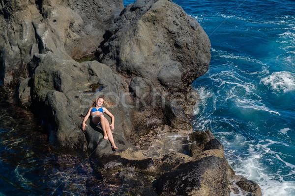 beautiful girl resting in natural ocean swimming pool Stock photo © svetography