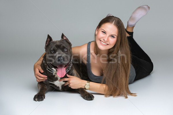 Beautiful girl with grey stafford terrier Stock photo © svetography