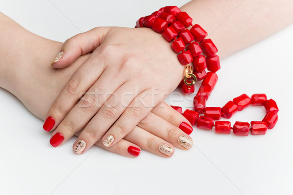 Woman hands with red and gold manicure Stock photo © svetography