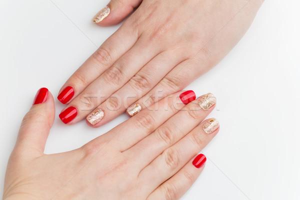 Nő kezek piros arany manikűr fehér Stock fotó © svetography