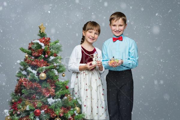 Children near christmas tree Stock photo © svetography