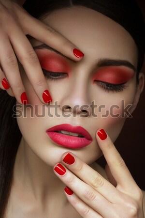 Bella ragazza labbra rosse bella giovani i capelli ricci studio Foto d'archivio © svetography