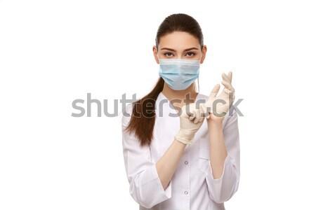 Mulher médico luvas de borracha isolado branco bela mulher Foto stock © svetography