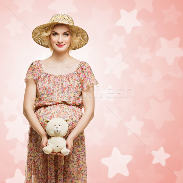 Pregnant woman with toy Stock photo © svetography