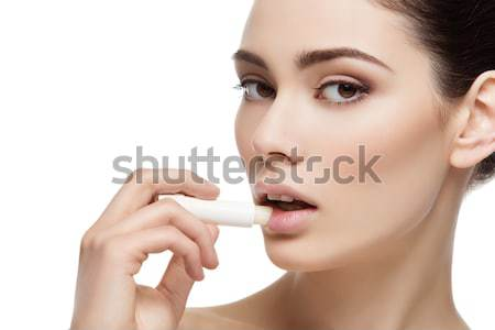 Beautiful middle aged woman with face serum Stock photo © svetography