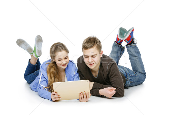 Teen boy and girl sitting with tablets Stock photo © svetography