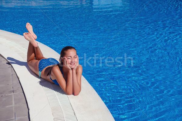 Stockfoto: Tienermeisje · ontspannen · zwembad · mooie · teen · leeftijd