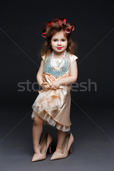 Cute little girl in dress and high heels Stock photo © svetography