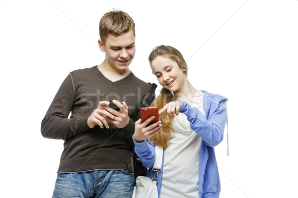 Teen boy and girl standing with mobile phones Stock photo © svetography