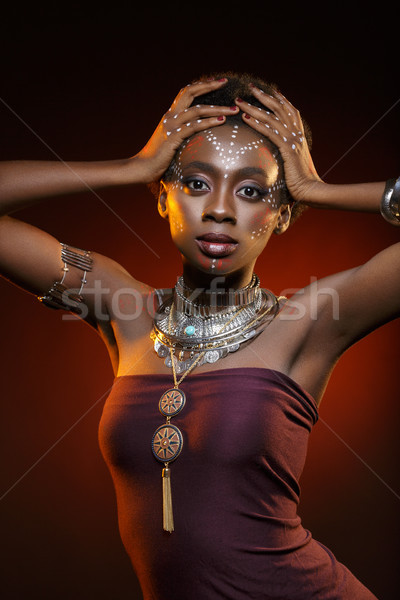 Beautiful afro girl with drawings on skin Stock photo © svetography